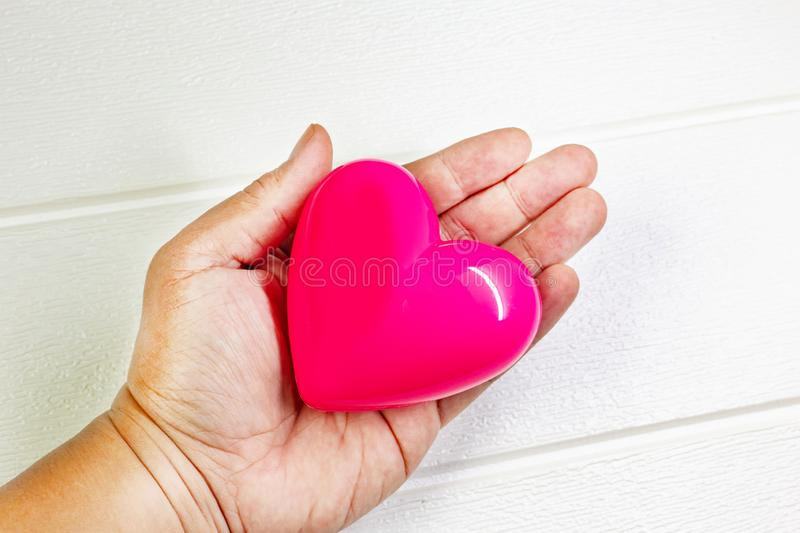 Pink Heart and hand for medical content royalty free stock images