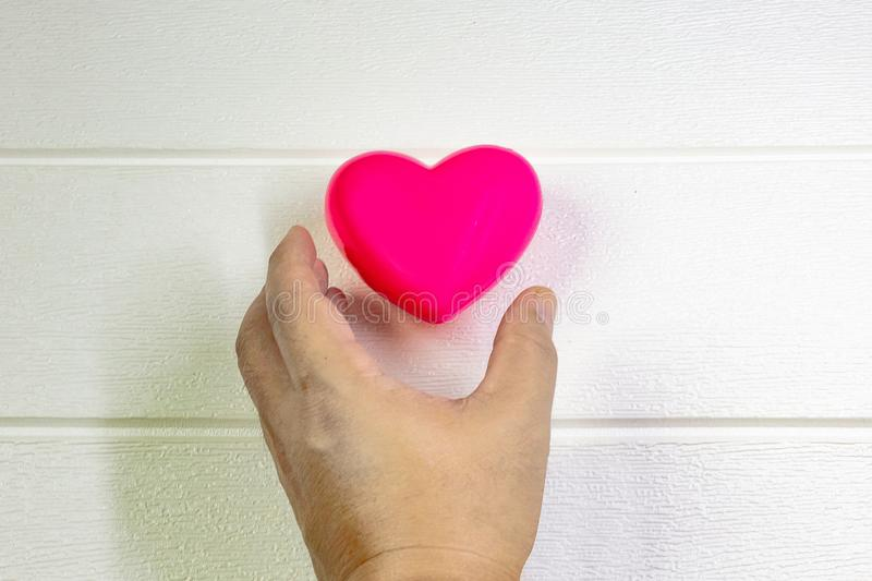 Pink Heart and hand for medical content stock photos