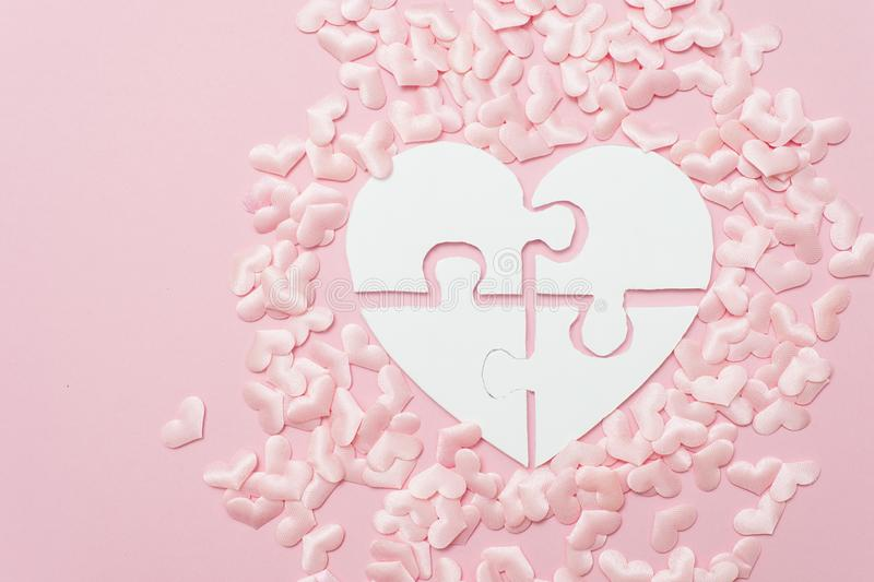 Pink heart puzzle shape decoration background. Autism concept royalty free stock images