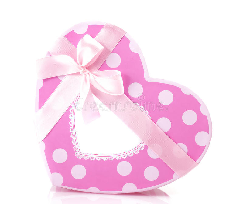 Pink heart-shaped gift box. Picture of beautiful pink heart-shaped gift-box isolated on white background, romantic present with decorative ribbon bow, Valentine royalty free stock photo