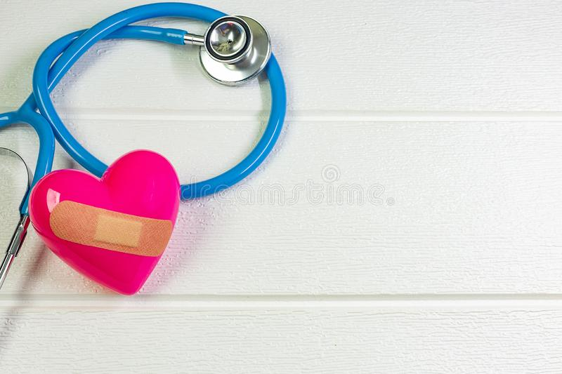 Pink Heart and stethoscopes for medical content stock photo