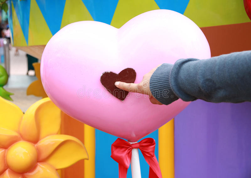 Pink heart is a symbol of love. Pink heart is a symbol of love and Fingers are pointing at symbol royalty free stock photography