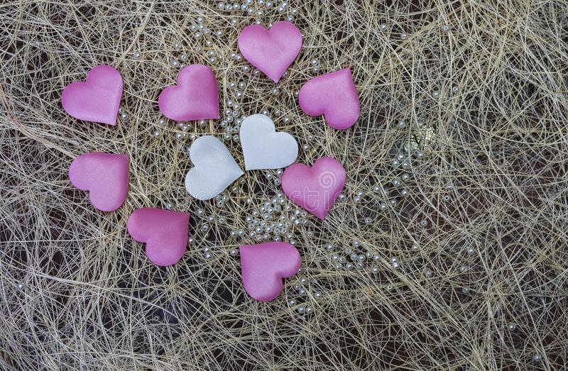 Pink heart on the wooden background. Provencal style. Pink heart on the wooden background. Pink white hearts on the wall royalty free stock photography