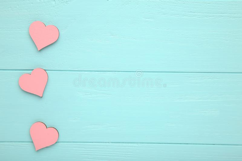 Pink hearts on a blue wooden background. stock photo