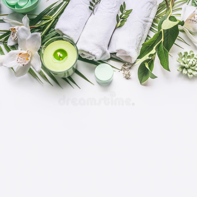 Pink herbal natural facial cosmetic products set with herbs and flowers on white background royalty free stock image