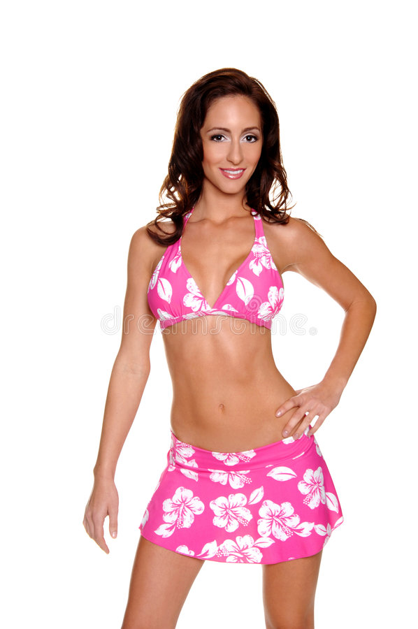 Pink Hibiscus Bikini. Beautiful young brunette in a pink and white hibiscus patterned bikini with a skirt cover up royalty free stock photography