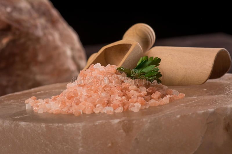 Pink Himalayan salt. Himalayan salt is rock salt from a mine in the Punjab Region of Pakistan. Salt sometimes occurs in a reddish or pink color royalty free stock image