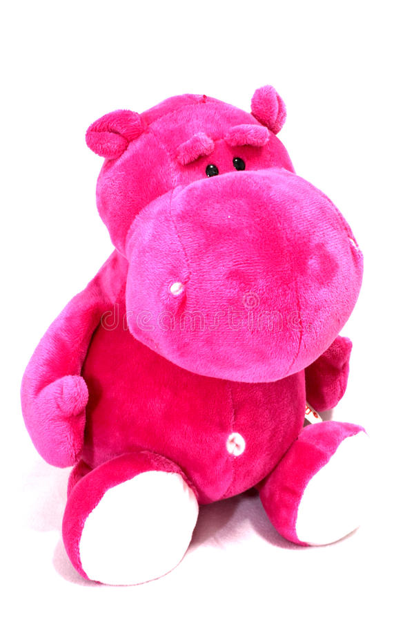 Pink hippo. Cute doll velvety stock images