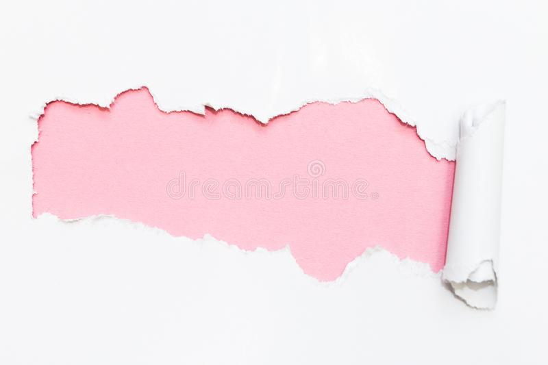 Pink hole in white paper. Empty space for text royalty free stock photos