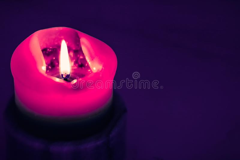 Pink holiday candle on purple background, luxury branding design and decoration for Christmas, New Years Eve and Valentines Day. Happy holidays, greeting card royalty free stock images