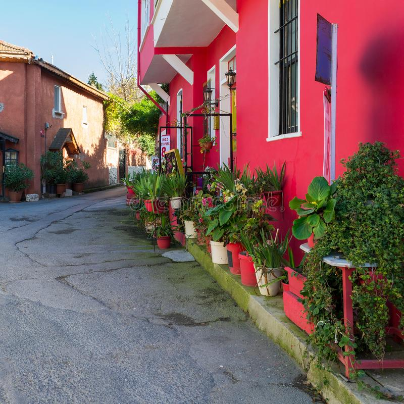 Pink house at Anadolu Kavagi, Istanbul, Turkey. Istanbul, Turkey - November 10, 2013: Street view with Pink house at Anadolu Kavagi stock photography