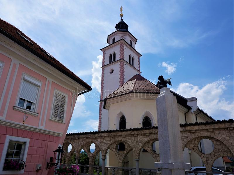 Pink house and St Roch`s Church in Kranj, Slovenia. Pink house and Saint Roch`s Church in Kranj, Slovenia royalty free stock photos