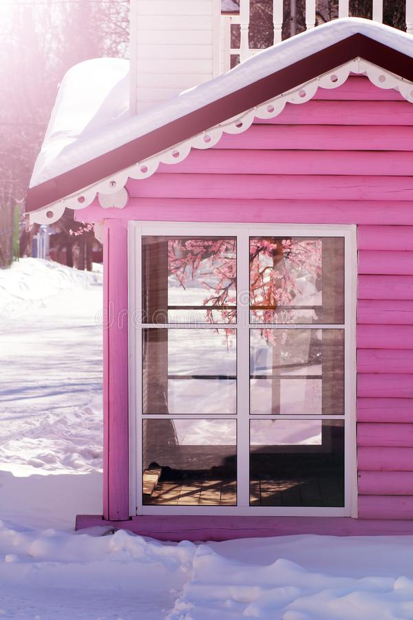 A pink house with white window royalty free stock image