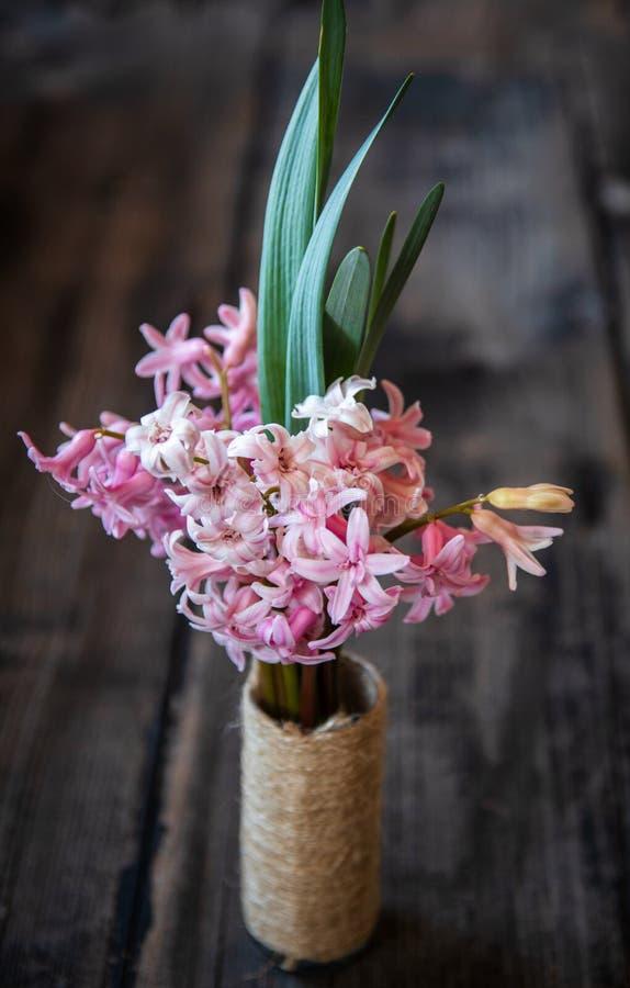 Pink hyacinth flower in homemade vase stock photo