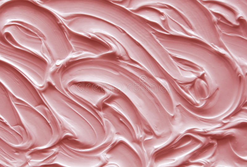 Pink icing. Close up of pink icing texture stock image