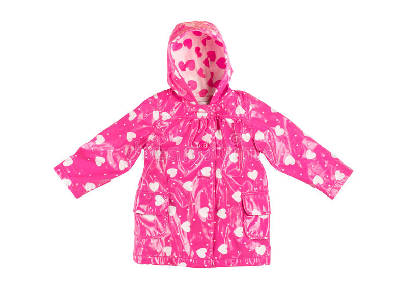 Pink jacket. Children's stylish fashionable lacquered pink jacket with white hearts for the little girl, windbreaker with hood, buttoned raincoat with pockets stock images