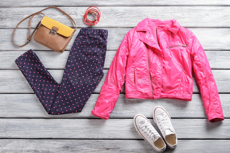 Pink jacket with dotted trousers. royalty free stock photo