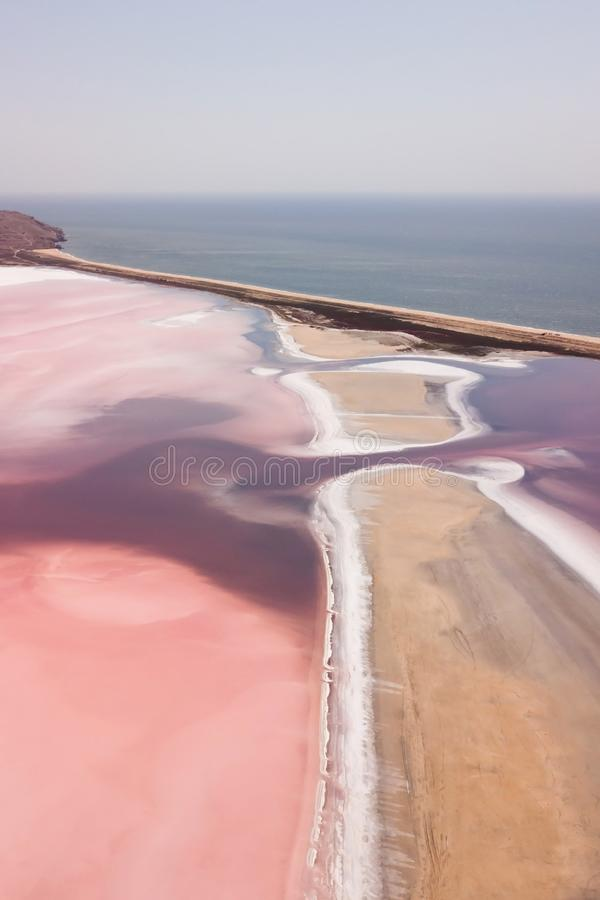 Pink Koyashskoye salt lake aerial panoramic view. Pink Koyashskoye salt lake in Krym and Black Sea coast. Aerial view. Trendy coral color stock images