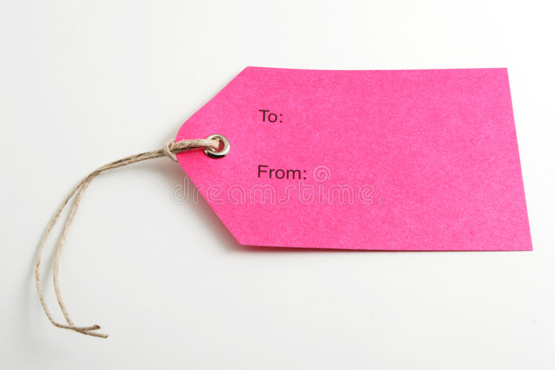 Pink label. Close up of a blank gift tag on white background royalty free stock photos