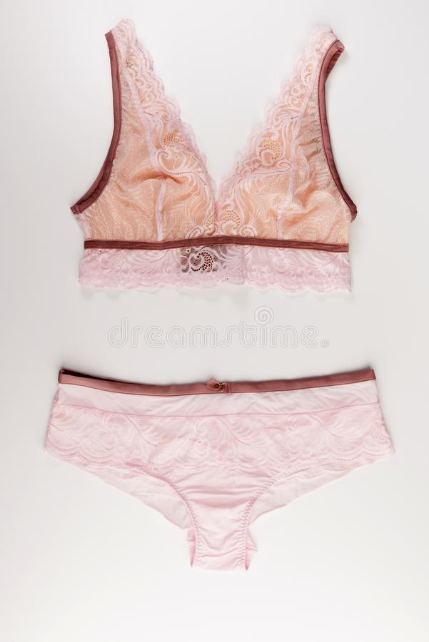 Pink lace tender lingerie set isolated on a white background. Top view royalty free stock photography