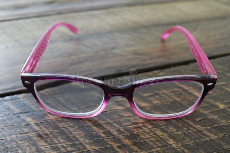 Stylish Pink Ladies Reading Eyeglasses royalty free stock image