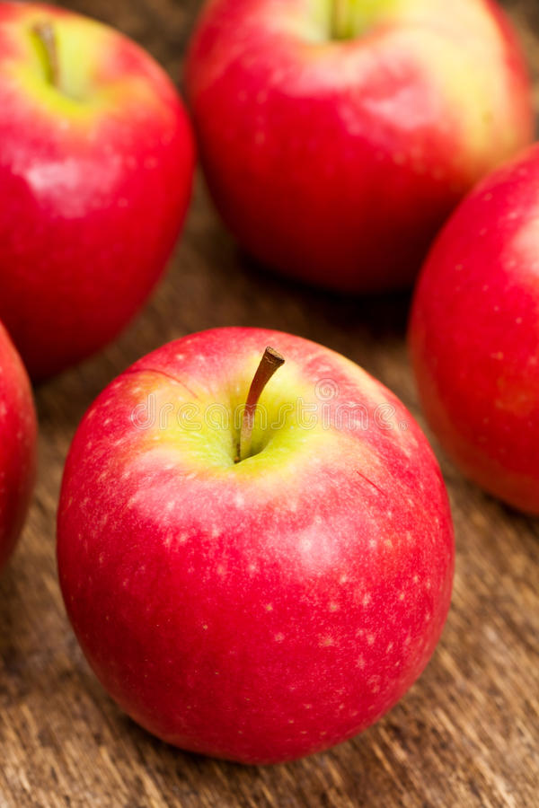 Download Pink Lady apples stock photo. Image of food, pink, wooden - 17892160