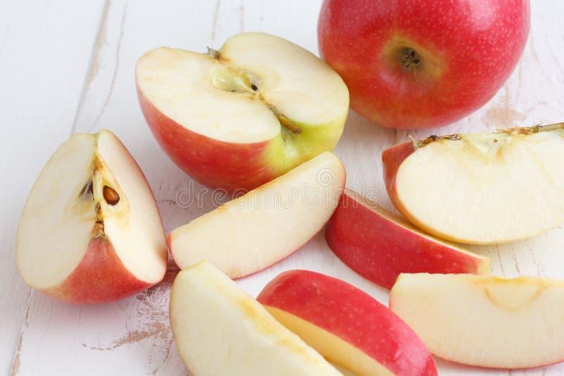 Pink lady apples cut stock photos