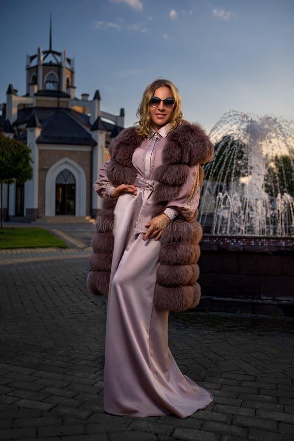Pink lady`s fur coat royalty free stock photos