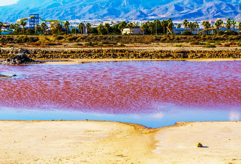 Pink lake in spain, unusual phenomenon, mineral influence on water. Rose river stock image