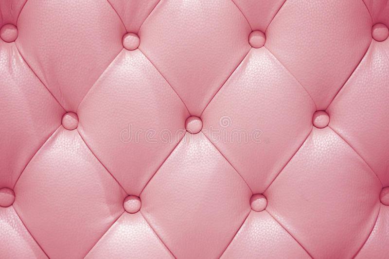 Pink leather sofa texture. As background stock photography