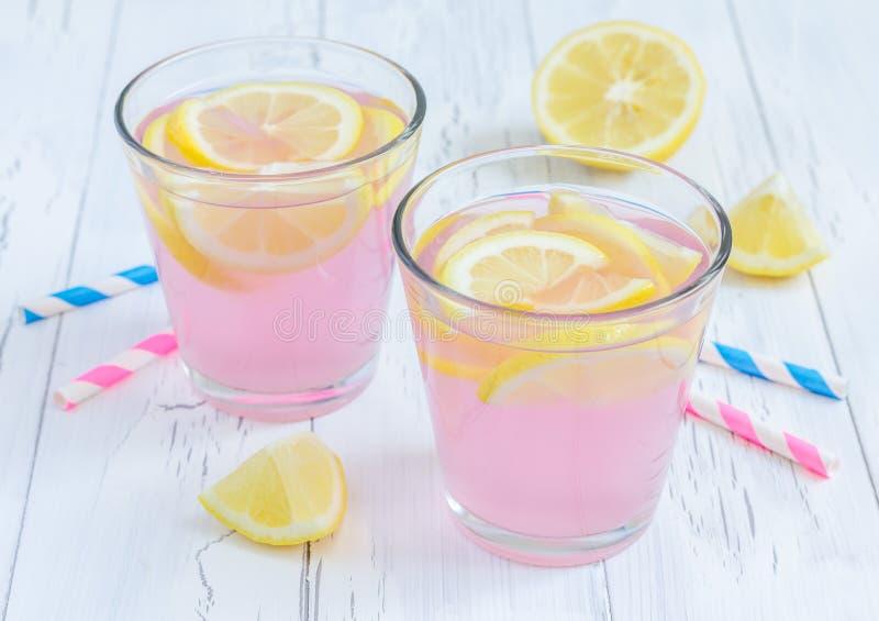 Pink lemonade with fresh lemons stock image