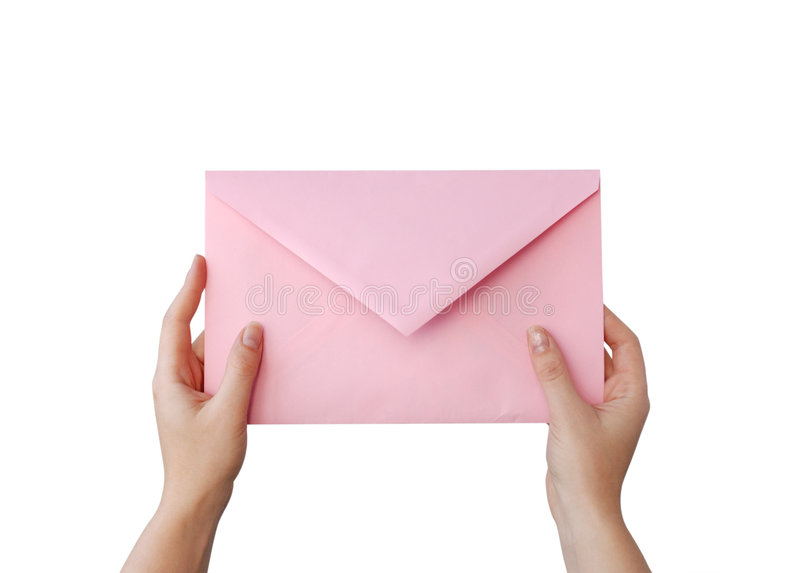 Pink letter. Hands with pink envelope on white stock photography