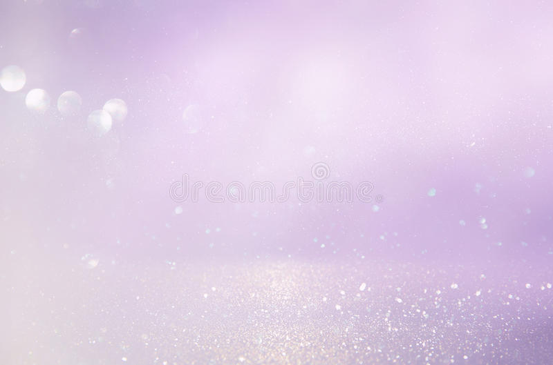 Pink, light purple and silver abstract bokeh lights. Defocused background stock images