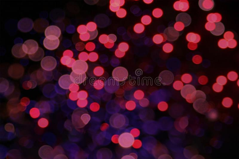 Pink and lilac bokeh highlights on black background. Pink and lilac bokeh highlights glare blur lights on black background stock images