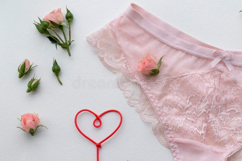 Pink lingerie panty. Fashion cloth, lingerie. Concept of love. Hand-made stock photos