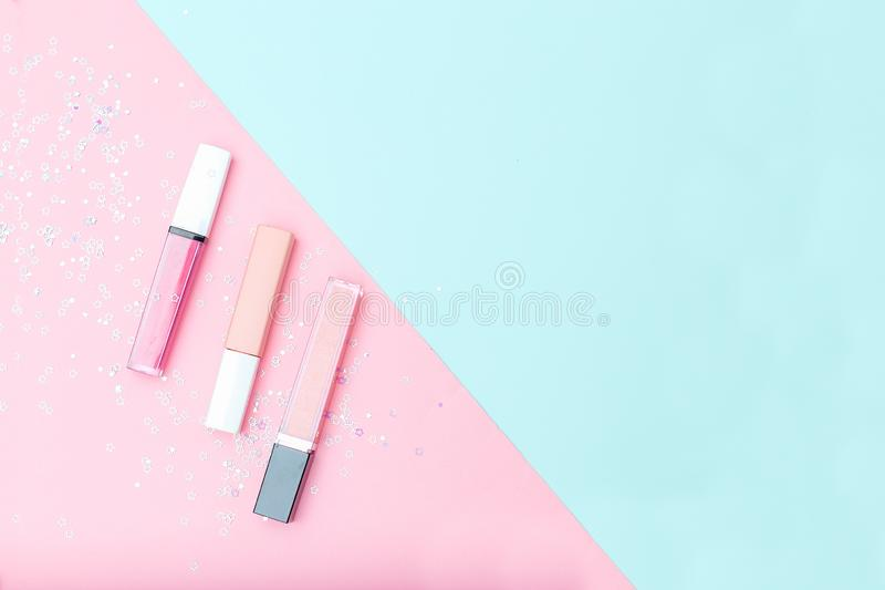 Pink lip gloss on a pink-blue background. Copy space. Pink lip gloss on a pink-blue background. Free space royalty free stock photo