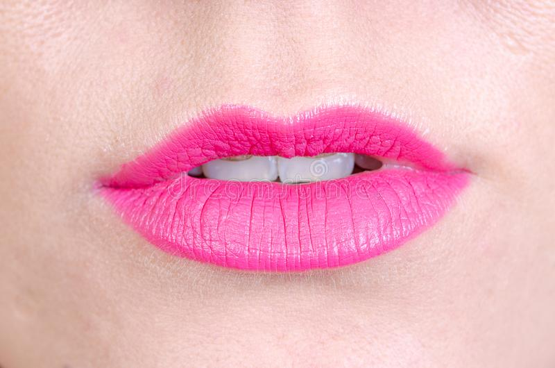 Pink lips of a young woman with a little open mouth royalty free stock photo