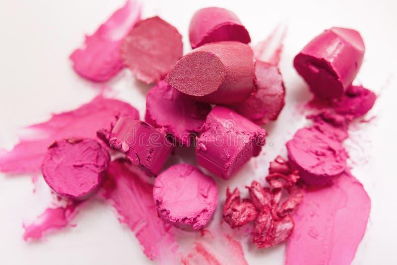 Pink lipstick chopped closeup on white background stock photos