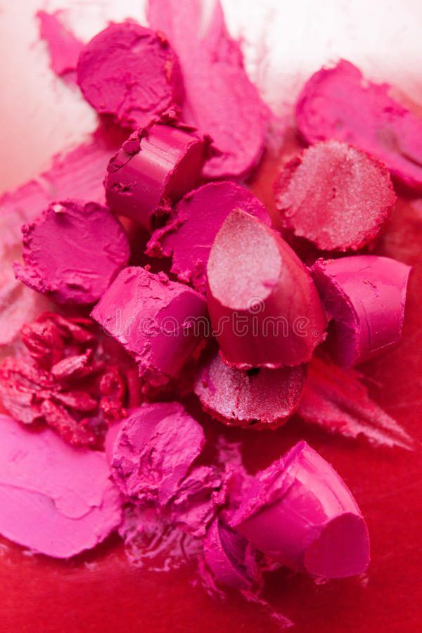 Pink lipstick sliced and cut pink closeup stock photography