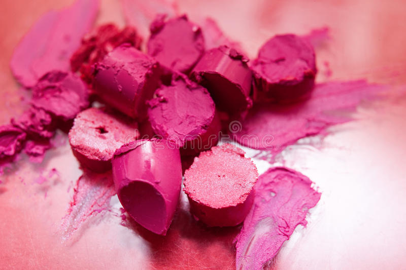Pink lipstick sliced samples closeup stock images
