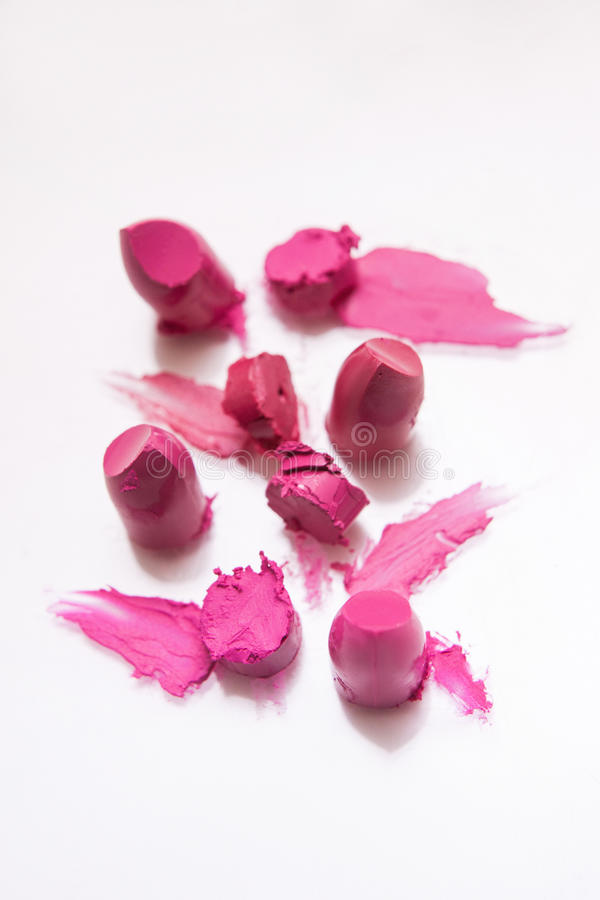Pink lipsticks cut samples on white background royalty free stock photography