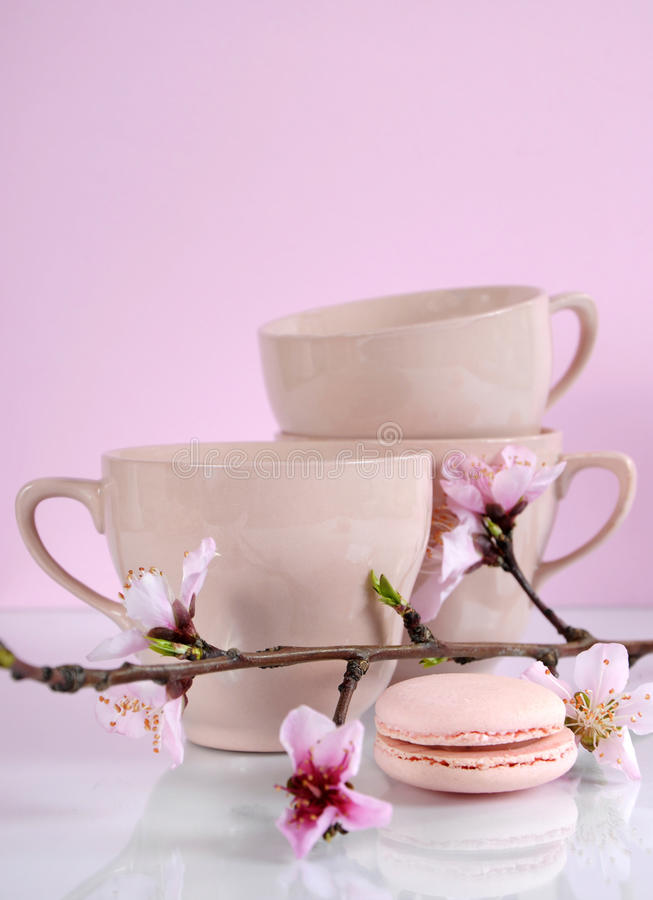 Pink macaron cookie with vintage cups stock image