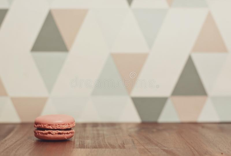 Pink macaron on the desktop royalty free stock image