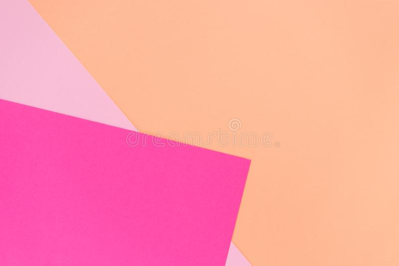 Pink, magenta and coral color papers geometric flat lying as background and template. Abstract modern background.  stock photo