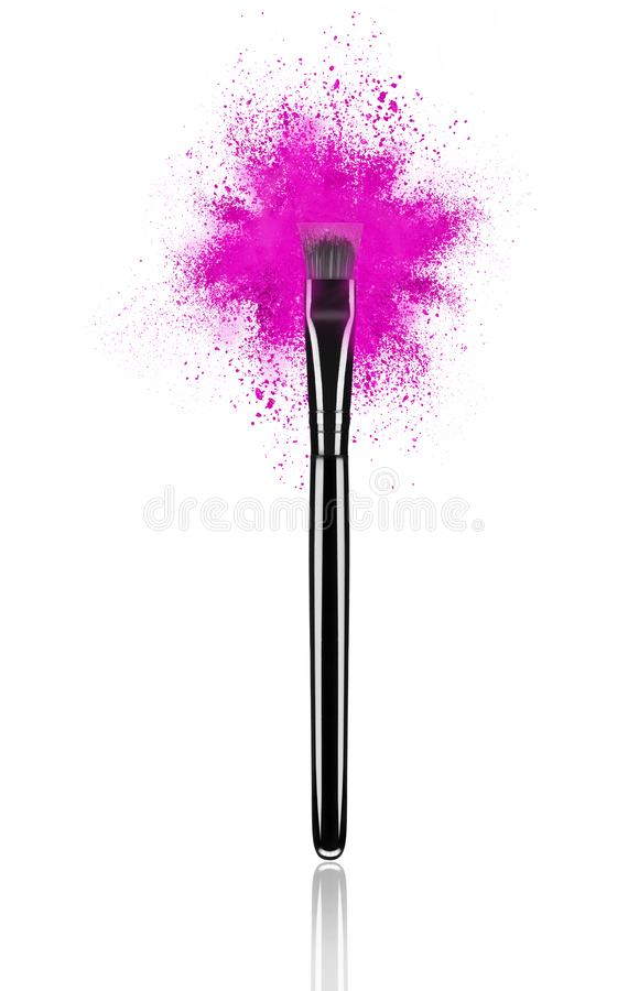 Pink make up brush with powder splash close-up royalty free stock photography