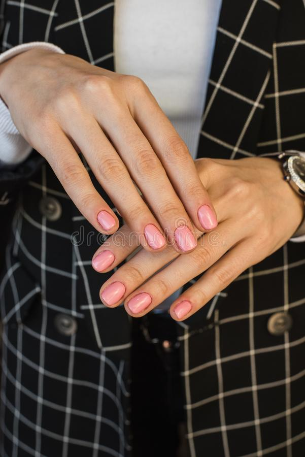 Pink manicure of the girl stock image