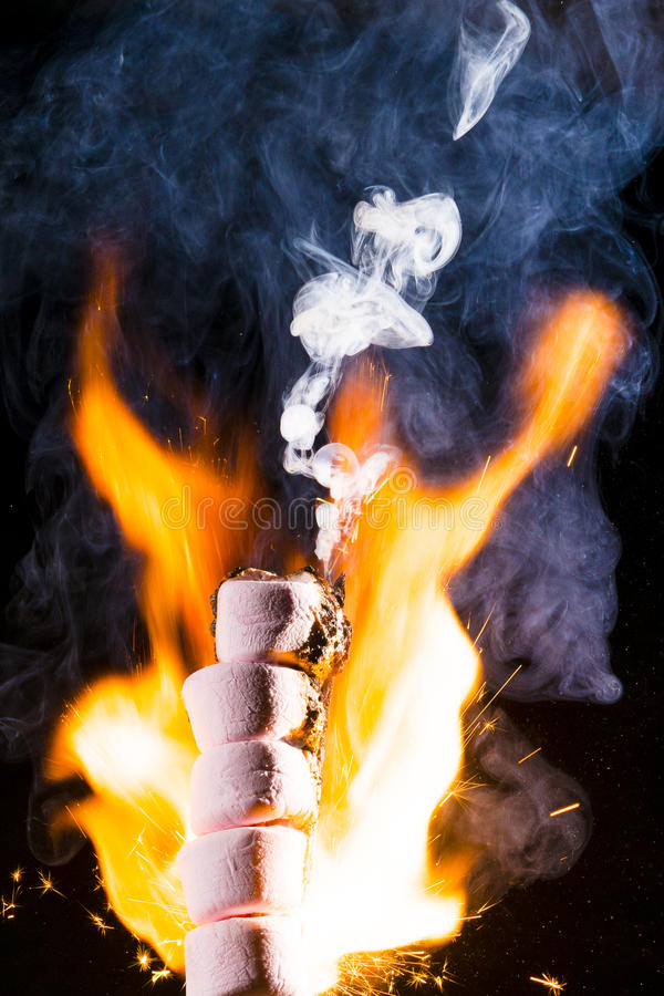 Pink Marshmallows on fire royalty free stock image