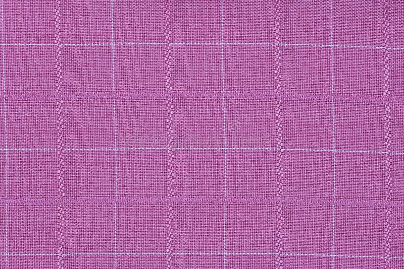 Pink material into grid, a textile background stock photos