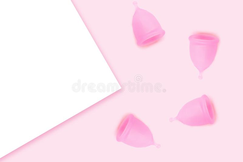 Pink menstrual cups on pink background. Flat lay, top view. copy space. Alternative feminine hygiene product during the period. Eco zero waste concept stock illustration