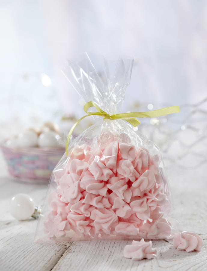Pink meringue cookies. On white wooden table stock photos
